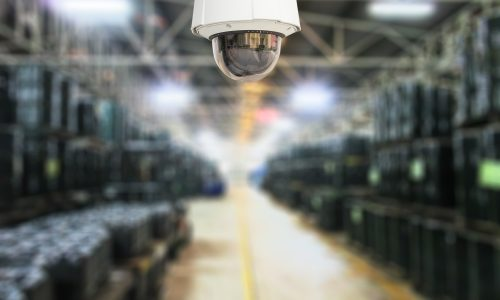CCTV system security of products in warehouse blur background.
